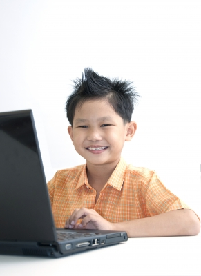 orange shirt kid play laptop